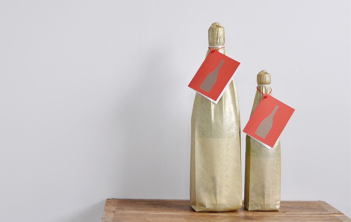 日本酒オヤジナカセのラッピング_金の和紙調袋
